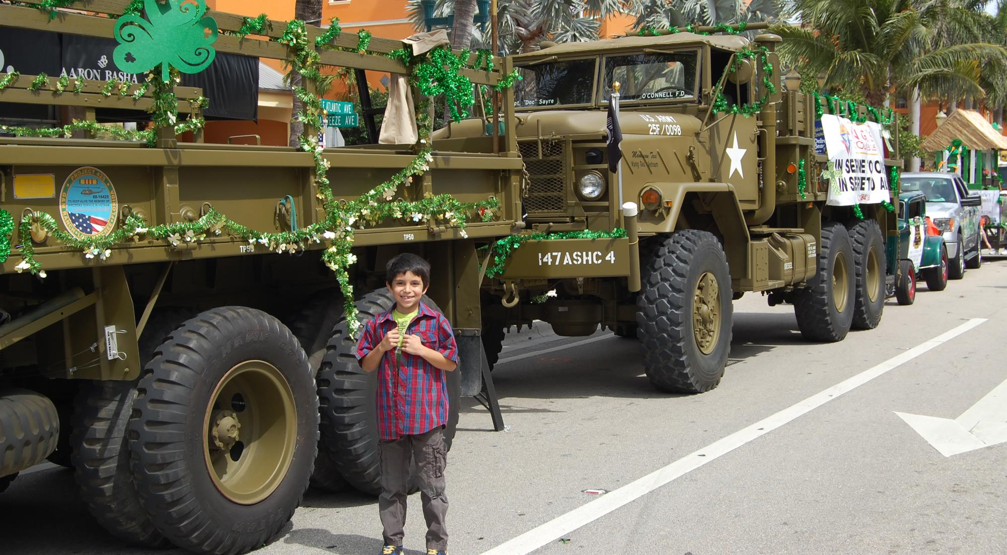 St Patrick Parade boy and trucks